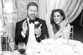 Black white photo bride in Inbal Dror wedding dress and groom in tuxedo clapping wedding speeches