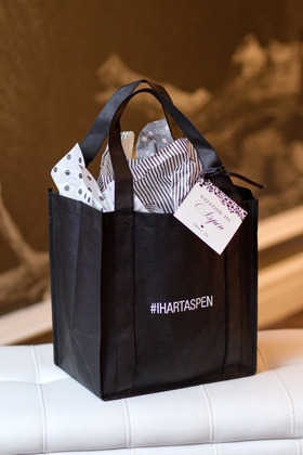 White and black bag printed with wedding hashtag