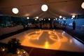 Wedding reception dance floor with couple's monogram projection