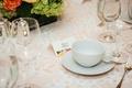 White eyelet linen over blush linen flower motif bridal shower place card tea cup