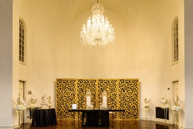 regal wedding sweetheart table with high-back chair with gold backdrop