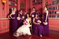 Bride sitting down with bridesmaids in library room