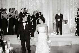 Black and white photo of Brett Sterling exiting ceremony