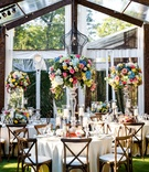 Wedding reception wood tent clear white colorful tall centerpiece designs wood chairs