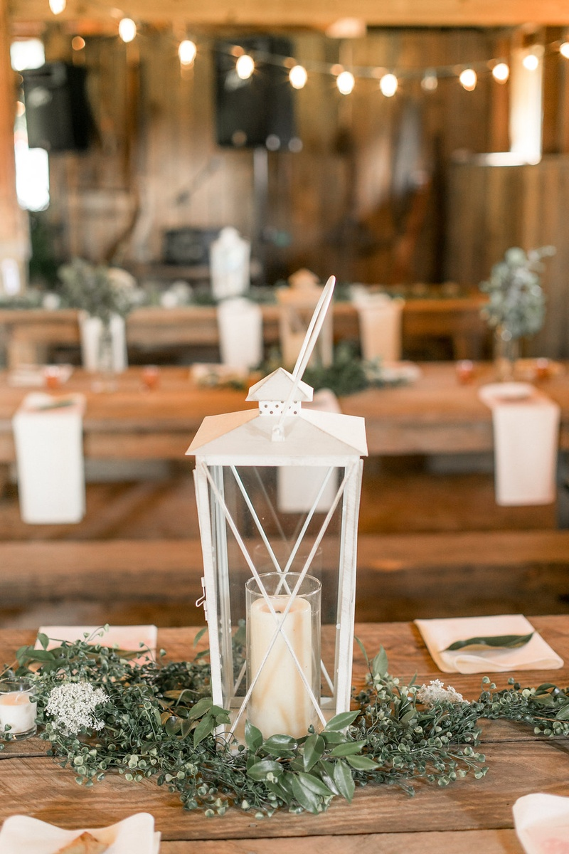 Wedding reception wood table white lantern
