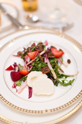 Wedding reception dinner salad with baby arugula, strawberries, raddichio, candied walnuts