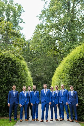 groom and groomsmen in bright blue suits brown dress shoes for rustic wedding