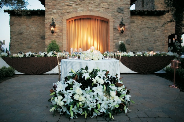 Outdoor wedding reception head table decorations