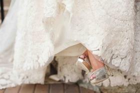 Lace wedding dress and metallic Jimmy Choo heels