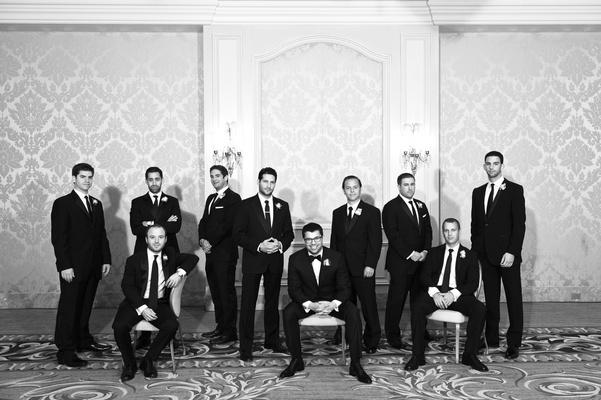 Black and white photo of men in tuxedos