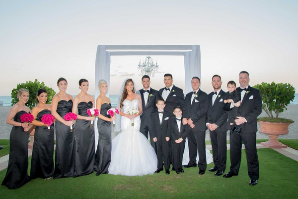 wedding party charcoal grey black bridesmaid dresses groomsmen in tuxedos ring bearers pink flowers