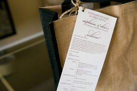 Burlap tote bag with wedding weekend itinerary attached