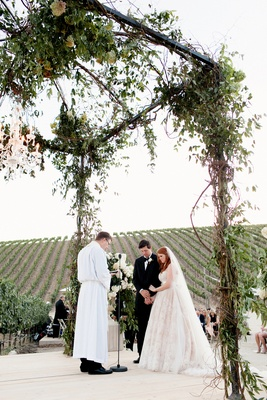 Vineyard wedding ceremony structure made of vines