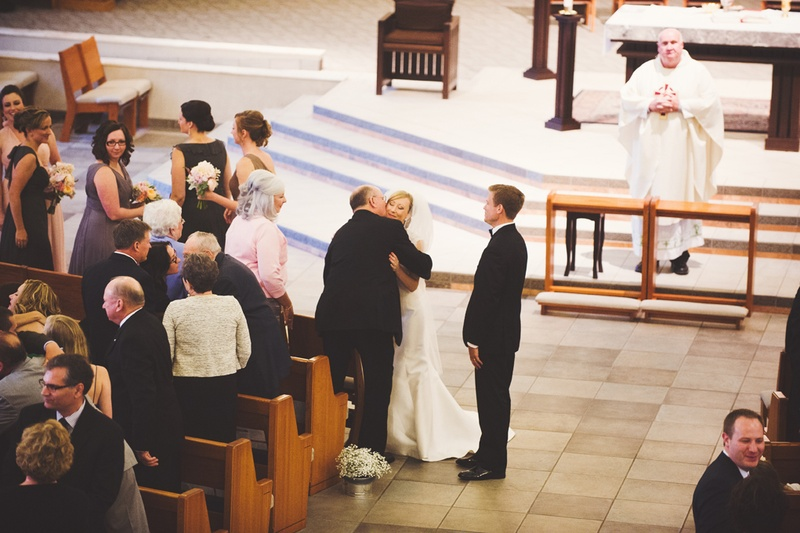 the bride's father gives her away at the ceremony