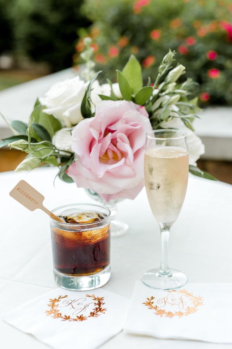 wedding reception cocktail hour rose gold foil napkins monogram jack me up hashtag wood stirrer