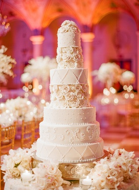 Seven layer cake with lattice roses and pearls