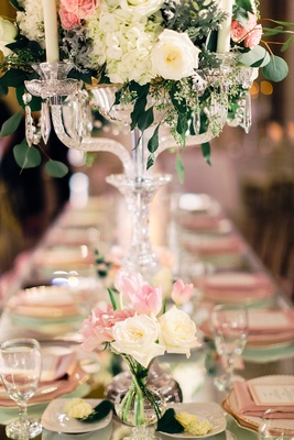 crystal candelabra centerpiece with white rose hydrangea greenery pink flower and smaller bud vase