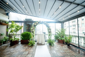 loft wedding venue with surrounding floor to ceiling windows
