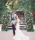 wedding portrait bride and groom outdoors loose bouquet navy blue suit brown dress shoes