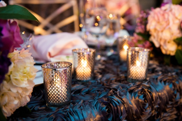 Candle vases with a lattice design on rosette linens