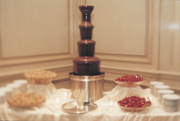 chocolate fountain and cream puffs and berries