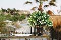 wedding reception bar tulip flower arrangement black vessel champagne flutes on tray mirror bar