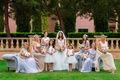 Bride in Kleinfeld wedding dress with bridesmaids mismatch dresses and flower girls flower crown