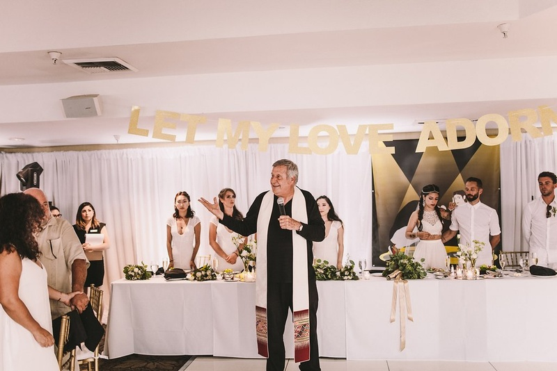 Irish Catholic Priest Giving A Blessing For Wedding Reception Dinner