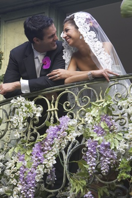 Couple on balcony adorned with flowers