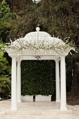hotel bel-air wedding ceremony gazebo with white flowers and branches