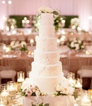 Wedding cake six layer cake with flower lace design to match bride's dress reception