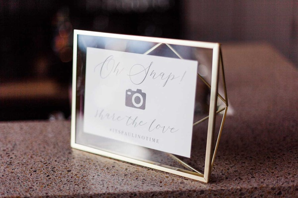 geometric frame with oh snap photo camera sign for wedding hashtag social media