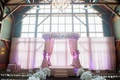 Wedding canopy beneath exposed wood beams