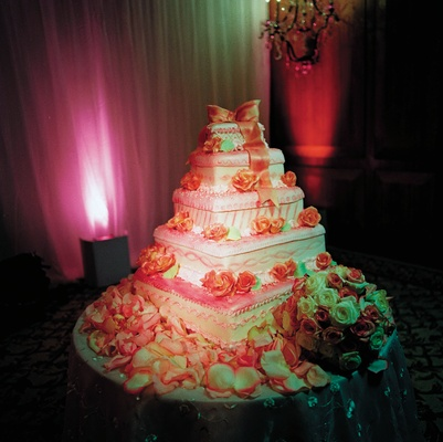 Five layer wedding cake with pink bow cake topper