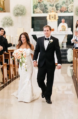 Bride in a Anna Maier ~ Ulla-Maija fit-and flare dress with lace jacket, groom in black tuxedo