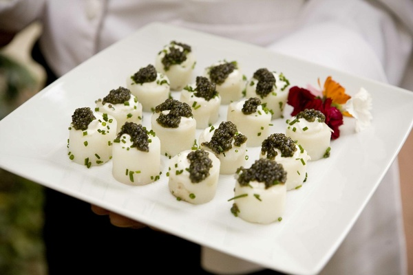 White tray with white appetizer and green caviar