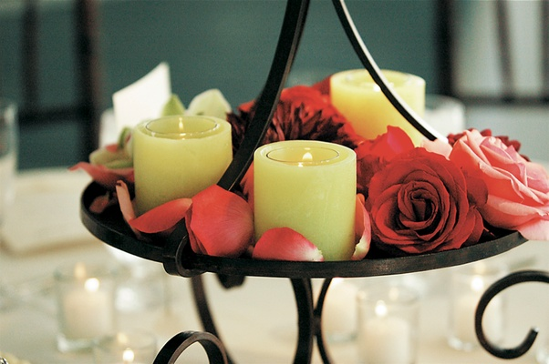 Cherry florals and yellow candles on centerpieces