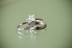 Four prong diamond engagement ring and wedding bands