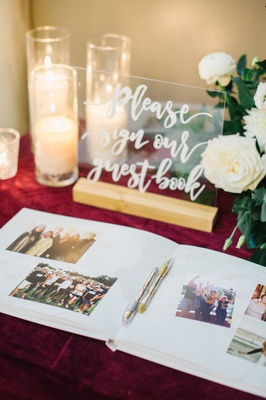 modern calligraphy on lucite acrylic sign for guest book area guest book with photo memories