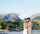 bride in flower crown and lihi hod dress, groom in grey suit, maui hawaii destination wedding