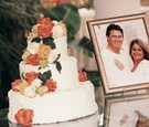 White wedding cake with orange and white roses