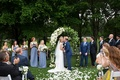 Guest takes photo with iphone as bride and groom kiss at wedding ceremony cell phone blue wedding