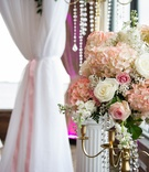 Hydrangeas and roses on gold candelabrum
