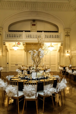 gold chiavari chairs with white poofy chair sashes