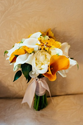 Bridal bouquet with orange and yellow flowers