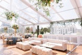 clear tent wedding reception flower chandelier tufted lounge furniture white gold tables bar shelves