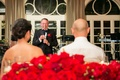 father of the groom laughs while giving his toast to the newlyweds