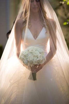 White v neck halter top vera wang wedding dress with ranunculus bouquet white