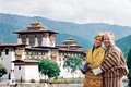 Newlyweds in front of landmark in the Kingdom of Bhutan