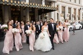bride groom bridesmaids groomsmen walk across new york street together